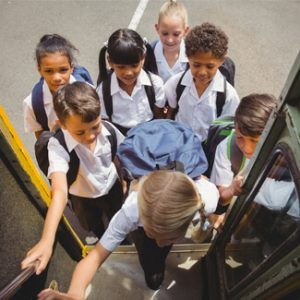 childrens onboarding bus for scholl trip